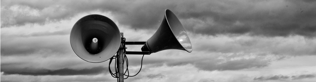 Black and white photograph of Two large megaphone or public announcement speakers